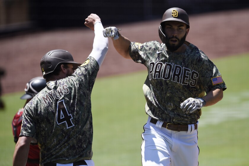 Padres' Eric Hosmer, right, celebrates with Wil Myers after hitting a solo home run Sunday.