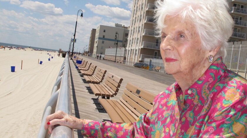 Lucille Horn stands on the boardwalk outside her home in Long Beach, N.Y., in 2015.
