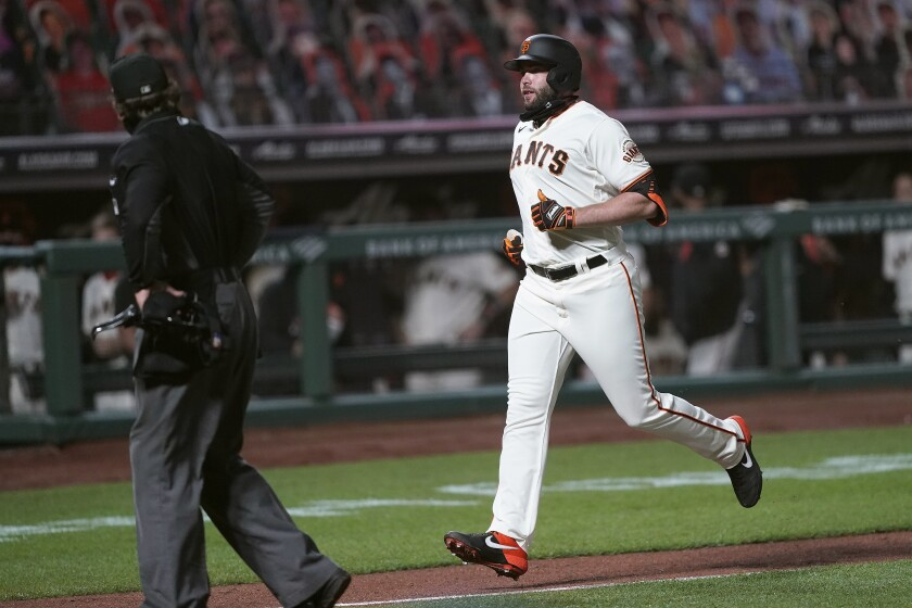 San Francisco Giants' Darin Ruf heads for home after hitting a solo home run against the Seattle Mariners during the seventh inning of a baseball game Tuesday, Sept. 8, 2020, in San Francisco. (AP Photo/Tony Avelar)