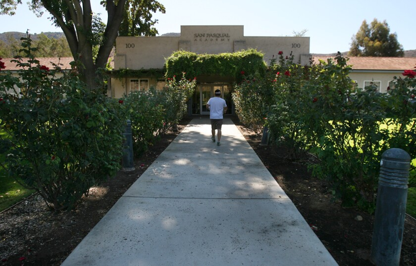 A person walked toward the front entrance of San Pasqual Academy in Escondido in a 2013 photo.