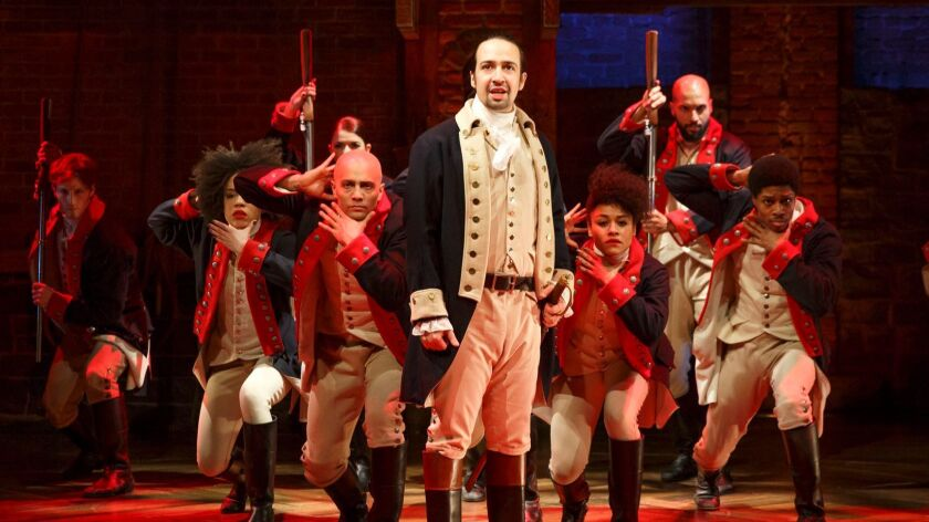 """Lin-Manuel Miranda, foreground, performs with members of the cast of the musical """"Hamilton"""" in New York."""