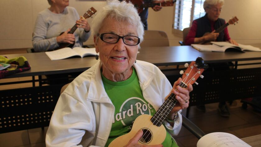 Eighty-four-year-old Carmen Ludwig practices some of the sing-along songs for The Ukulele Orchestra of Great Britain performance.