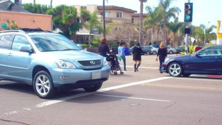 Close Call: This photo was taken Monday afternoon, April 15, 2013 at the intersection of Draper Avenue and Pearl Street in La Jolla. Do motorists and pedestrians belong in the crosswalk at the same time? (Photo by Ashley Mackin)