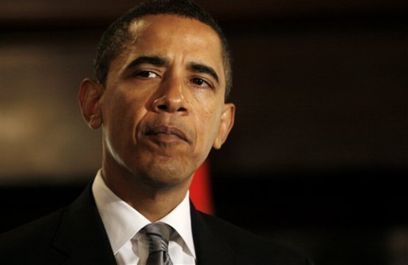 President-elect Barack Obama speaks to reporters during his meeting with Mexico's President Felipe Calderon, not pictured, in Washington,  Monday, Jan. 12, 2009. (AP Photo/Charles Dharapak)