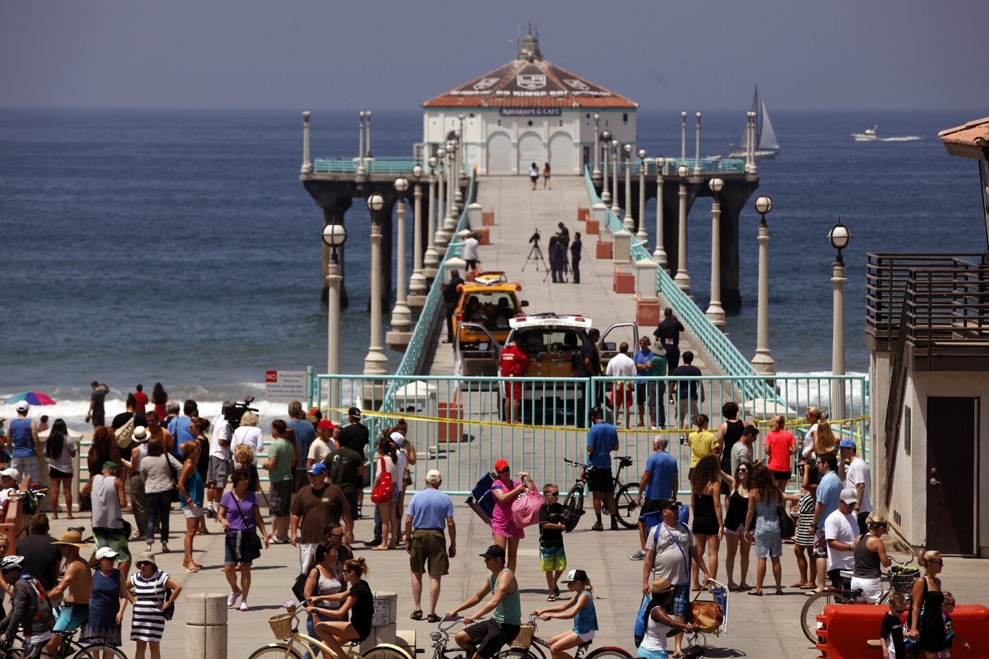 A man fishing from the Manhattan Beach pier hooked the shark and had it on his line for about an hour before the bite.