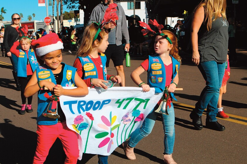 Members of Girl Scouts Daisy Troop 4779 march in the La Jolla Christmas Parade.