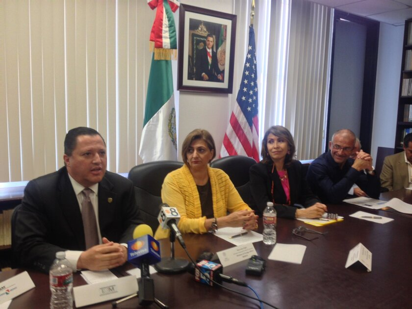 Rodulfo Figueroa, left, head of Mexico's federal immigration office in Baja California, during a news conference on Tuesday in San Diego to address Mexico's requirements for U.S. sportfishermen. At his side is Ana Luisa Fajer of Mexico's Foreign Ministry and Remedios Gomez Arnau, Mexico's Consul Ge