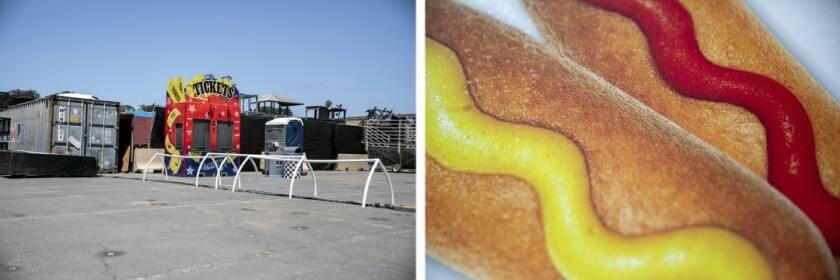 Left: A ticket booth sits unused in a fairground parking lot. Right: Corndogs are featured in a picture on the side of a vendor that sells fair food on the weekend as the Del Mar Fairgrounds lies empty during the coronavirus pandemic on May 27, 2020. Fairgrounds officials are asking people to support a request for $20 million in federal aid to help them weather the financial blow they've taken during the pandemic.
