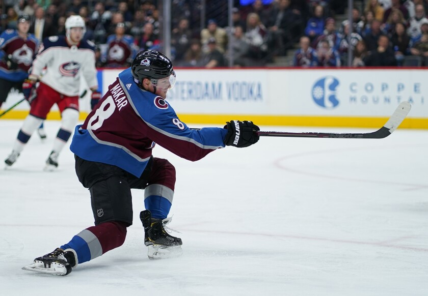 Colorado Avalanche defenseman Cale Makar (8) shoots a goal against the Columbus Blue Jackets during the second period of an NHL hockey game, Saturday, Nov. 9, 2019, in Denver. (AP Photo/Jack Dempsey)