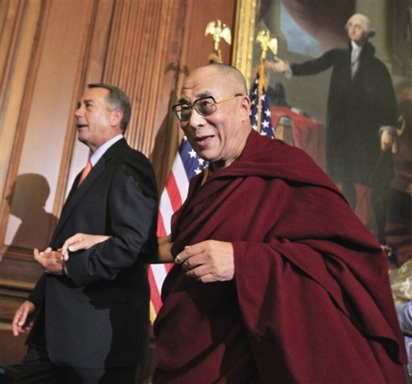 The Dalai Lama and House Speaker John Boehner of Ohio leave a news conference on Capitol Hill in Washington, Thursday, July 7, 2011. (AP Photo/Manuel Balce Ceneta)