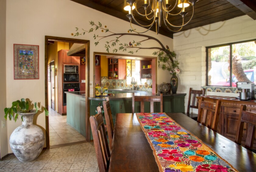 The dining room at Krichman Adobe features the whimsical styling and vivid colors favored by the current owner.