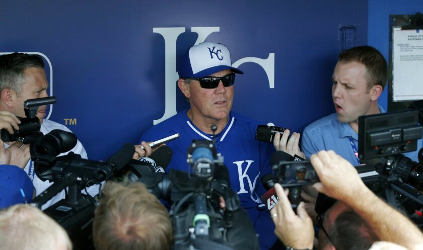 Kansas City Royals manager Ned Yost talks with reporter before a baseball game against the St. Louis Cardinals at Kauffman Stadium in Kansas City, Mo., Wednesday, June 4, 2014. (AP Photo/Orlin Wagner)