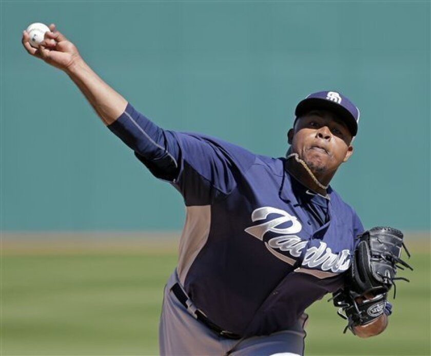 San Diego Padres starting pitcher Edinson Volquez, throws during the first inning of a spring training baseball game against the Cleveland Indians Saturday, March 2, 2013, in Goodyear, Ariz. (AP Photo/Charlie Riedel)