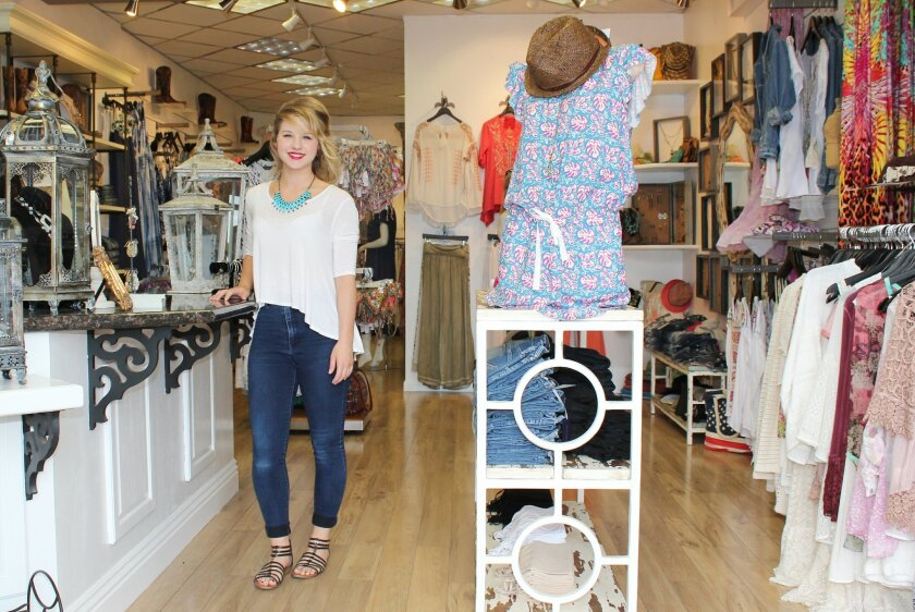 Sales associate Taylor Rindfleish welcomes guests to Blue Jeans and Bikinis at 1241 Prospect St.