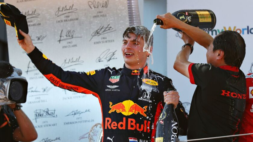 Formula One driver Max Verstappen is doused by Toyoharu Tanabe after winning the F1 Grand Prix of Austria on Sunday.