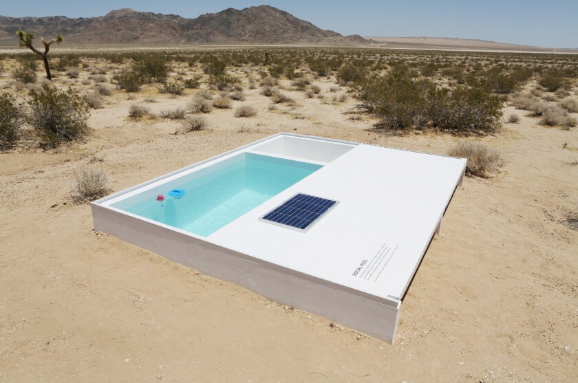 "A view of artist Alfredo Barsuglia's ""Social Pool,"" which he installed in a patch of road-less desert in the middle of the Mojave."