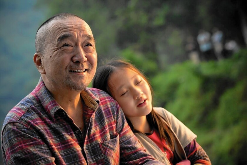 "Li Bao Tian and Yang Xin Yi in the Chinese-French movie ""The Nightingale."""