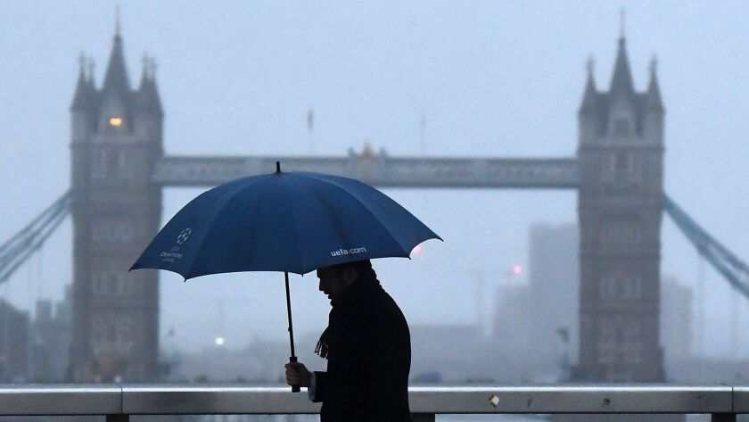 A Commuter walks over London Bridge in London, Britain on Jan. 15.