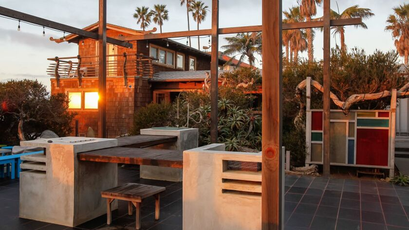 A view of the renovated 1913 Sunset Cliffs bungalow and its outdoor entertaining area.