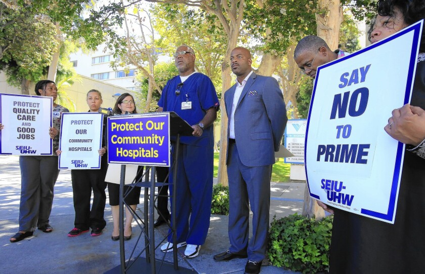 Hospital workers and union organizers hold a news conference at St. Vincent Medical Center in Los Angeles during a protest of the possible acquisition of six California hospitals to Prime Healthcare Services Inc.