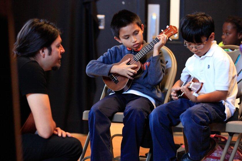 Instructor Pablo Cantua taught Ukelee at Ocean View Hills School's after-school program in 2015.