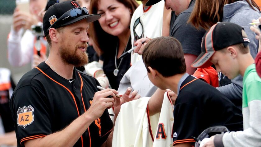 The Giants' Hunter Pence signs autographs prior to a spring training baseball game against the Oakland Athletics, Monday, Feb. 27, 2017, Matt York)