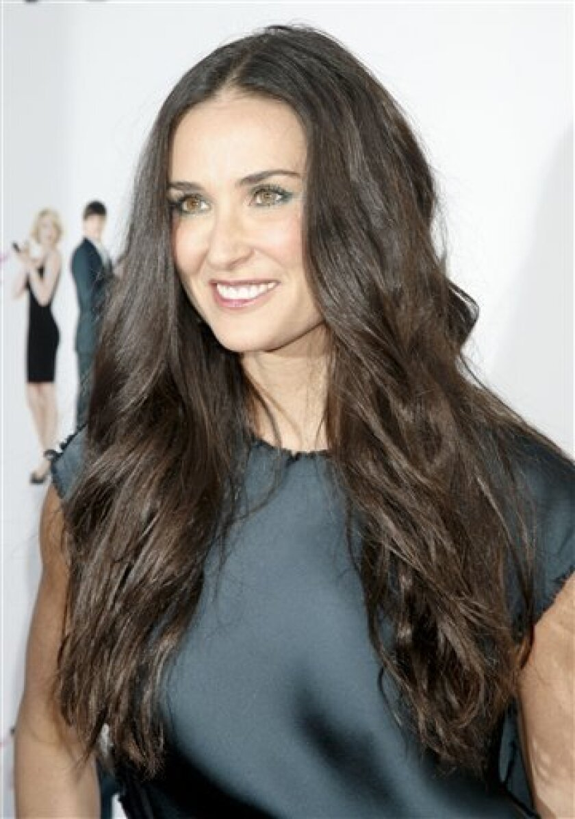 "Actress Demi Moore arrives at the ""Killers"" premiere on Tuesday, June 1, 2010, in Los Angeles. (AP Photo/Jason Redmond)"