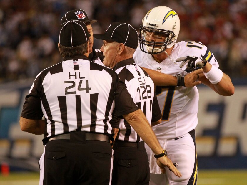 Philip Rivers tangles with officials after a third quarter TD by Eddie Royal was called into question. It was determined to be a TD.