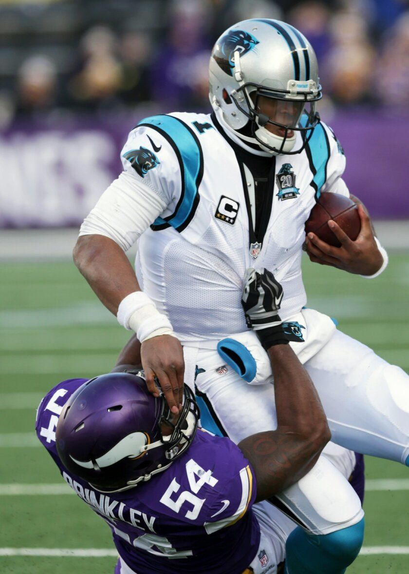 Carolina Panthers quarterback Cam Newton is tackled by Minnesota Vikings middle linebacker Jasper Brinkley (54) during the second half of an NFL football game, Sunday, Nov. 30, 2014, in Minneapolis. (AP Photo/Jim Mone)