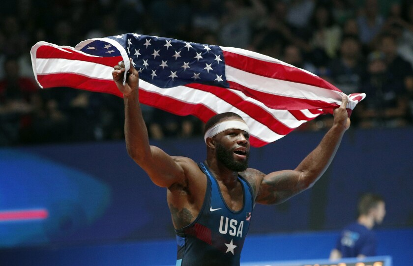 FILE - In this Saturday, Aug. 26, 2017, file photo, United States' Jordan Ernest Burroughs celebrates after defeating Khetik Tsabolov, of Russia, in the men's freestyle 74-kg category during the final of the Wrestling World Cup at the Paris Bercy Arena, in Paris, France. Burroughs, the face of U.S. wrestling for nearly a decade, said Wednesday, July 15, 2020, he plans to compete another four years with the hope of finishing his career at the Paris Olympics. (AP Photo/Christophe Ena, File)