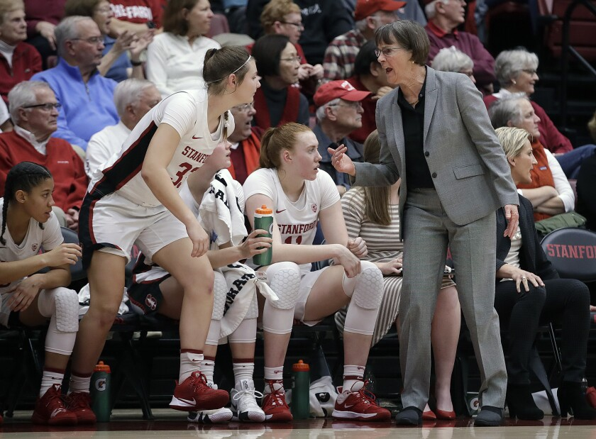 Stanford coach Tara VanDerveer, right, calls guard Hannah Jump (33) to the game during the first half against Tennessee on December 18, 2019 at Stanford.