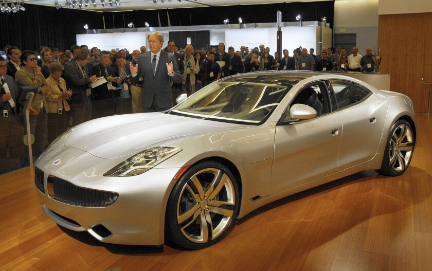 In 2009, Henrik Fisker shows his Karma plug-in car in L.A. Battery glitches resulted in a recall, and the firm was bought out of bankruptcy in 2014. Cars from the Moreno Valley plant could go on sale in mid-2016.