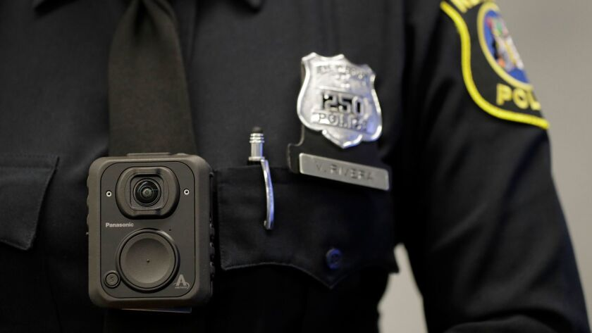 Newark Police officer Veronica Rivera wears a body camera during a news conference at the Panasonic