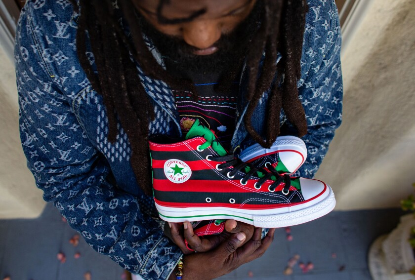 Tremaine Emory with the sneakers he designed inspired by the Pan-African flag