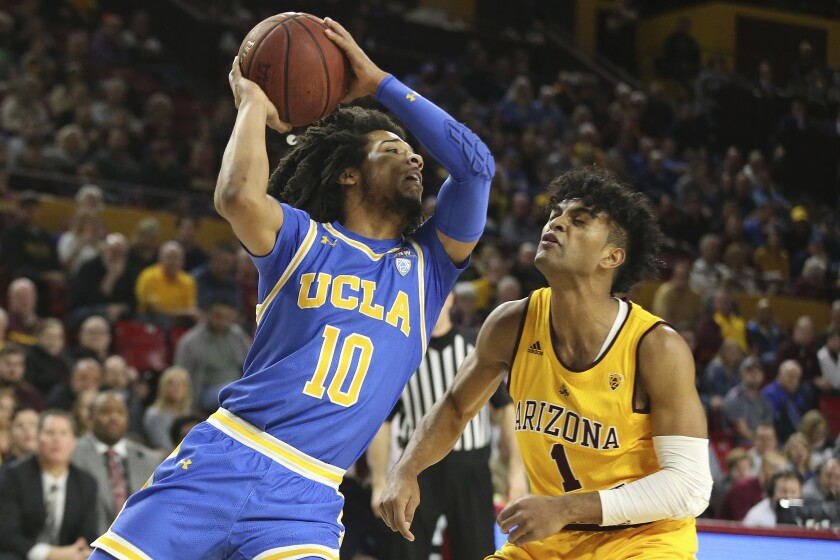 UCLA's Tyger Campbell looks to pass as Arizona State's Remy Martin (1) defends during the first half of a game Feb. 6 at Desert Financial Arena.