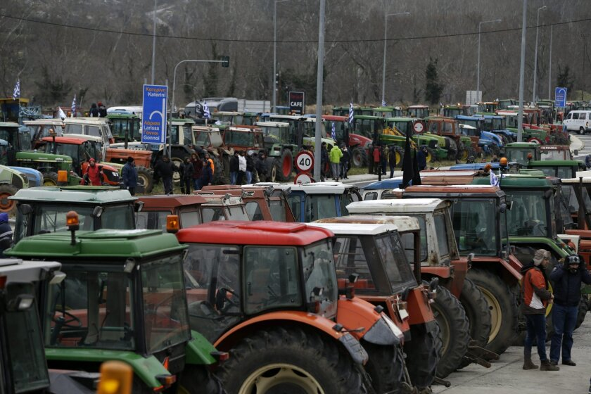 FILE - In this Wednesday, Jan. 20, 2016 file photo, protesting farmers from the agricultural region of Thessaly park their tractors in the Vale of Tempe, central Greece. Protest organizers said on Tuesday, Feb. 9, 2016 that the tractor blockade on the highway linking Athens to Greece's second large