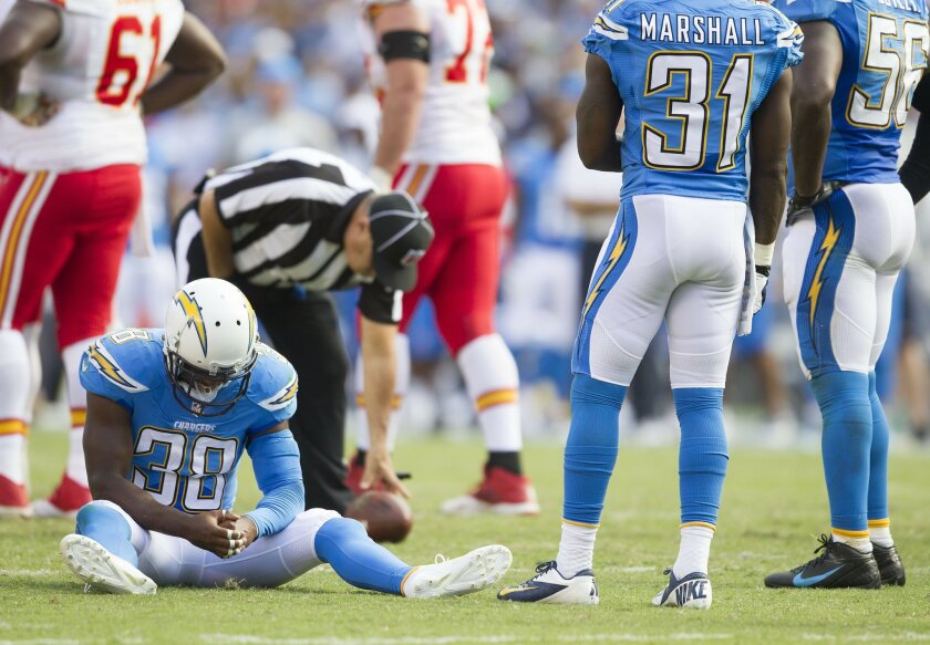 San Diego Chargers strong safety Marcus Gilchrist (38) sits on the ground after being injured in the second half.