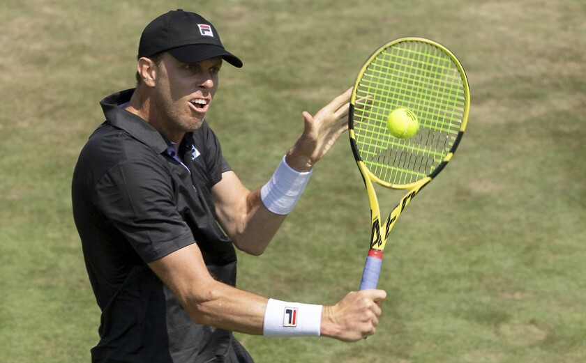 Sam Querrey of the United Stares return the ball during his match against Dominic Stricker from Switzerland at the ATP tennis tournament in Stuttgart, Germany, Friday, June 11, 2021 . (Marijan Murat/dpa via AP)