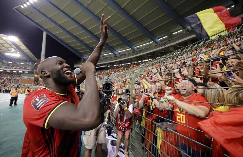 Belgium's Romelu Lukaku, left, celebrates after winning the World Cup 2022 group E qualifying soccer match between Belgium and the Czech Republic at King Baudouin stadium in Brussels, Sunday, Sept. 5, 2021. (AP Photo/Olivier Matthys)