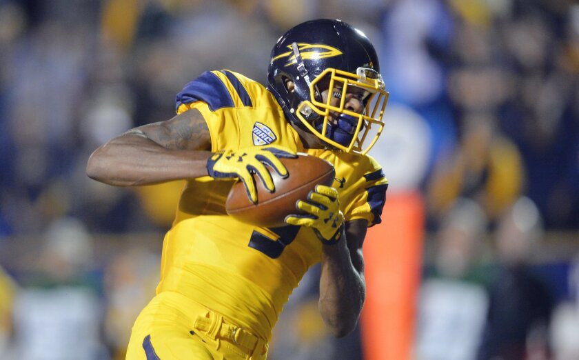 Toledo wide receiver Alonzo Russell catches a touchdown pass during the first quarter of an NCAA college football game against Northern Illinois on Tuesday, Nov. 3, 2015, in Toledo, Ohio. (AP Photo/David Richard)