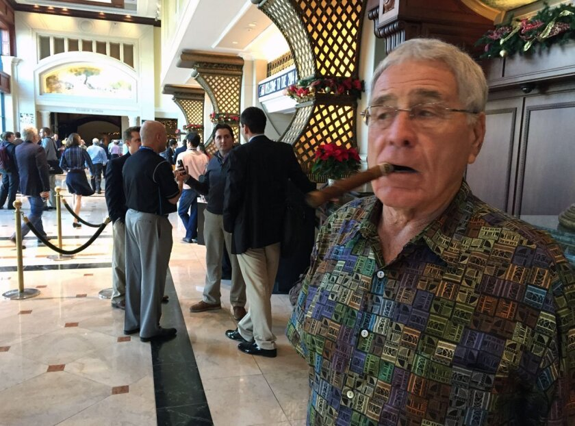 Former Padres GM and manager Jack McKeon scans the crowd at the Winter Meetings in the lobby of the Manchester Grand Hyatt. McKeon said he has been coming to the Winter Meetings for 60 years.