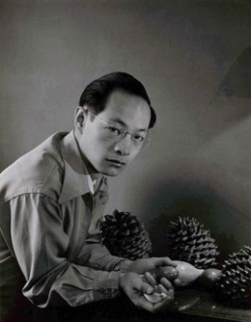 """Portrait of Benjamen Chinn by Minor White taken in 1949. White included some Chinn photos in an exhibition called """"Perceptions"""" at the San Francisco Museum of Art in 1954. Chinn studied under Ansel Adams after WWII at the California School of Fine Arts, where lecturers included such noted photographers as Imogen Cunningham, Dorothea Lange and Lisette Model."""