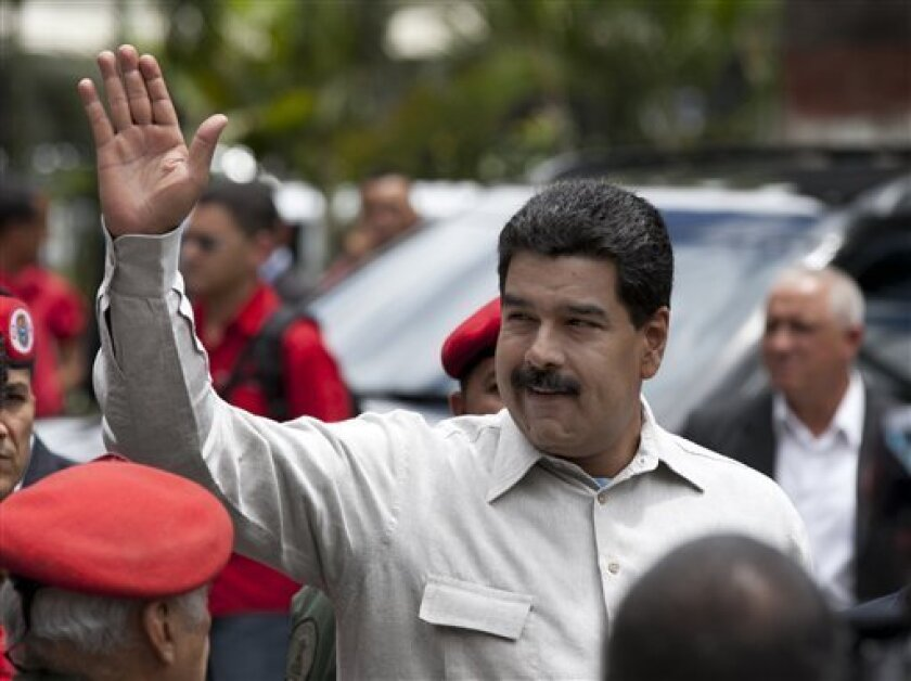 FILE - In this Oct. 2, 2013 file photo, Venezuela's President Nicolas Maduro waves during a visit to the Bolivarian National Guard command in Caracas, Venezuela. Maduro announced Thursday evening, Oct. 24, 2013, the creation of a new ministry known as the Vice Ministry of Supreme Happiness. (AP Pho
