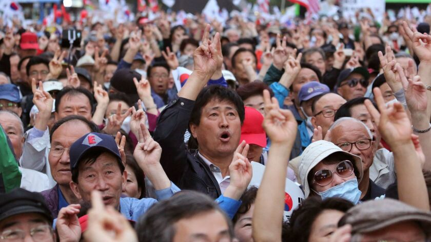Supporters of South Korean presidential candidate Hong Joon-pyo of the Liberty Korea Party shout his