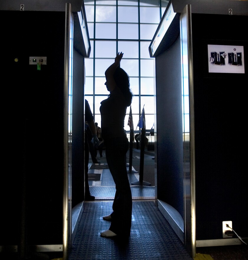 FILE - In this Nov. 24, 2010, file photo. an unidentified passenger participates in a full-body scan at the El Paso International Airport in El Paso, Texas. The metal detectors that greet sports fans at the gates might soon be accompanied by thermal body scanners, in the gargantuan task of better protecting venues from virus spread in order to bring the games back for in-person viewing. (Mark Lambie/The El Paso Times via AP, File)