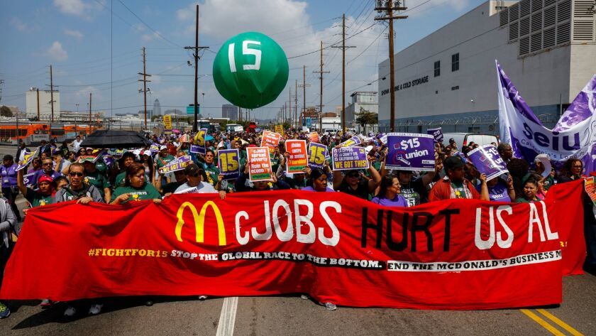 Workers marched down Alameda in downtown Los Angeles in an attempt to gain support for a $15-per-hour minimum wage on April 14, 2016.
