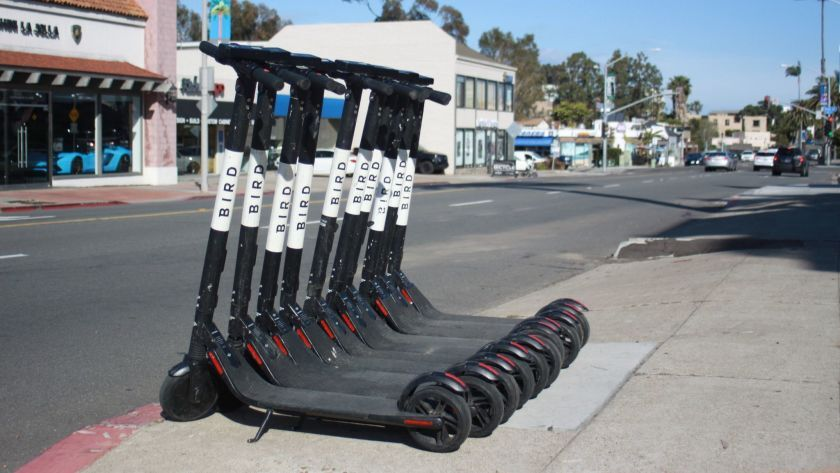 Electric scooter ridership has dropped by half since the summer, according to new City figures. Pictured are scooters parked on La Jolla Boulevard.