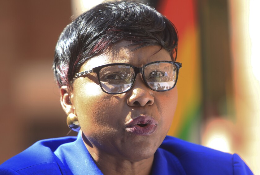 FILE - In this July 31, 2015 Oppah Muchinguri, then Zimbabwean Minister of Environment, Water and Climate, addresses a press conference in Harare, Now Defence Minister Muchinguri has described the coronavirus as God's way of punishing the United States and other western countries for imposing sanctions on Zimbabwe, prompting the president to issue a statement Monday, March 16, 2020 restating his government's commitment to fighting COVID-19. (AP Photo/Tsvangirayi Mukwazhi, File)