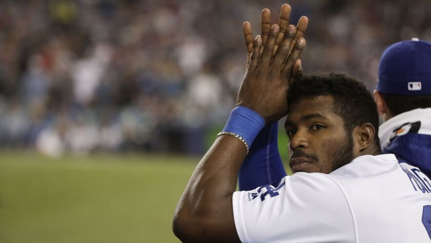 Los Angeles Dodgers right fielder Yasiel Puig watches during the ninth inning in Game 5 of the World