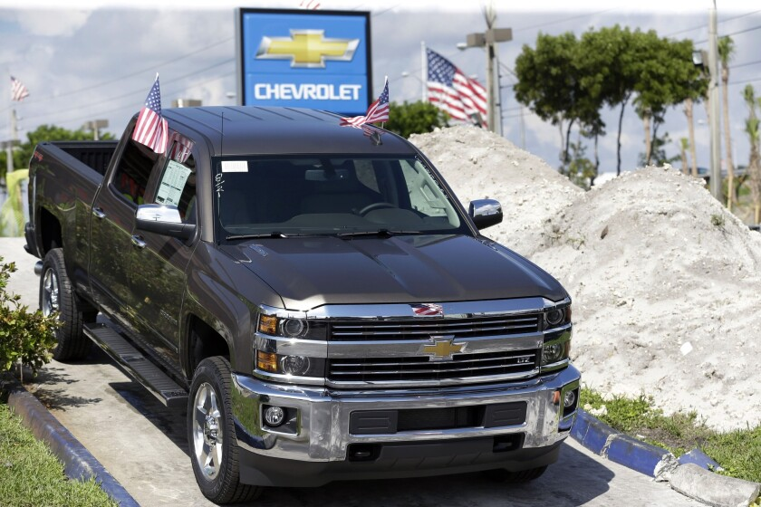 Strong sales of pickups like this Chevrolet Silverado helped boost General Motors.